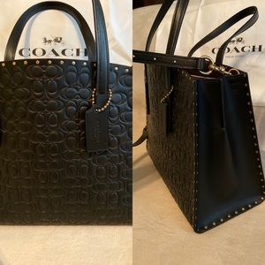 Coach signature Charlie carryall with brass rivets